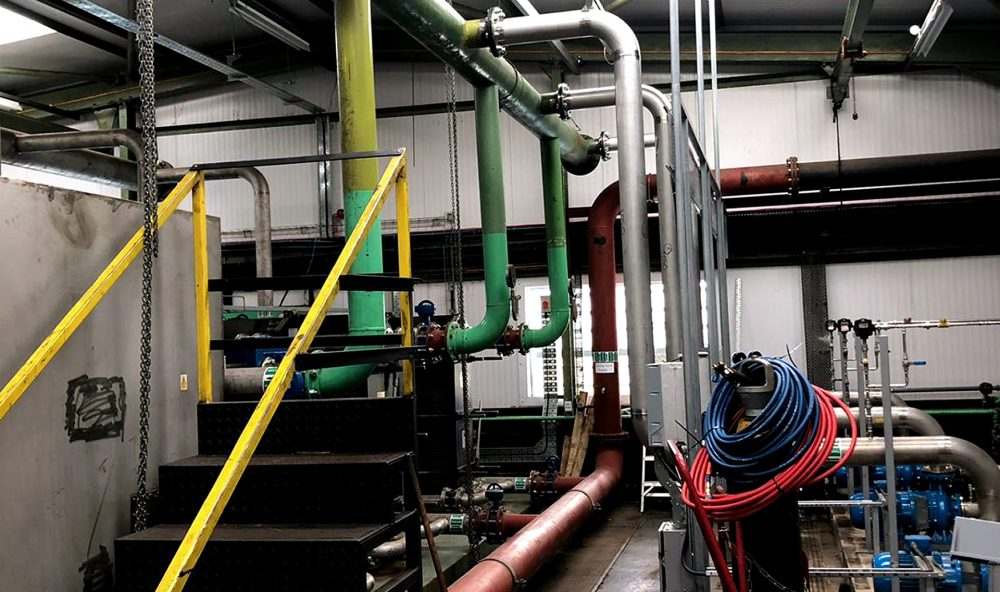 Green pipework at high level inside a building