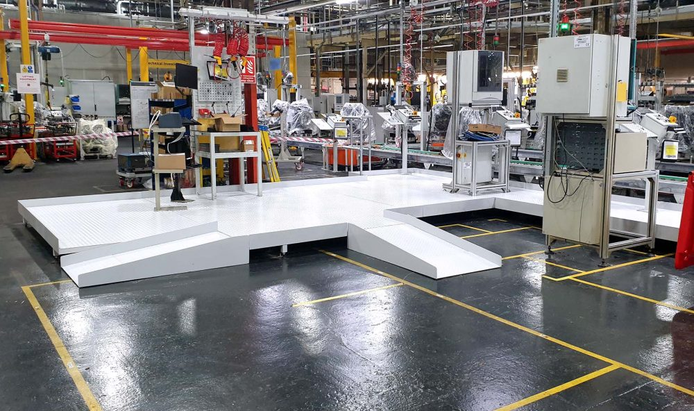 White assembly line platforms and ramps