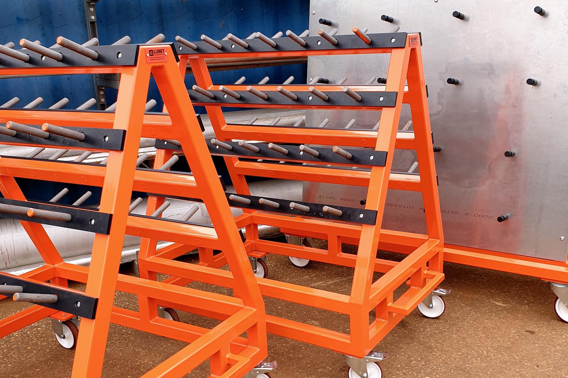 Three orange parts trolleys lined up